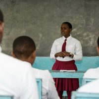 Kisa Scholar presents in front of class thanks to sponsor | AfricAid | Denver, CO