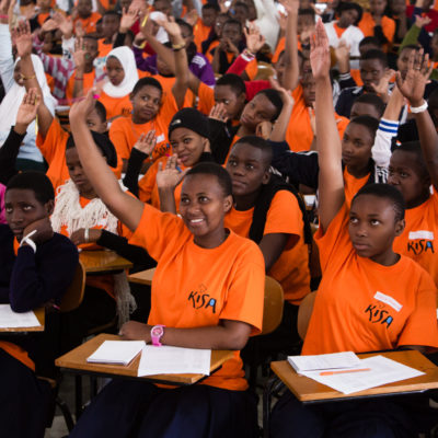 scholars raise their hand to answer questions on career day thanks to sponsor support | AfricAid | Denver CO