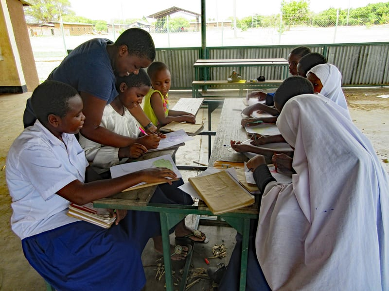 Scolastica mentors local kids while attending Kisa | AfricAid | Kisa Project | Denver, CO