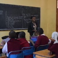 female mentor teaching a class thanks to sponsor's support | AfricAid | Denver, CO